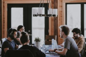 Team meeting round a table. Welcome to Venerate Solutions, a world leading salesforce consultancy. Click to read our salesforce blog with articles and insights.